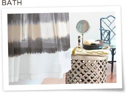 Nate Berkus shower curtain and assorted bathroom items on stand