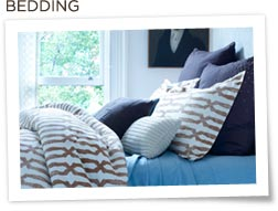 Nate Berkus bedding and pillows on bed