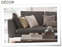 Nate Berkus throw pillows on couch with coffee table and books in front